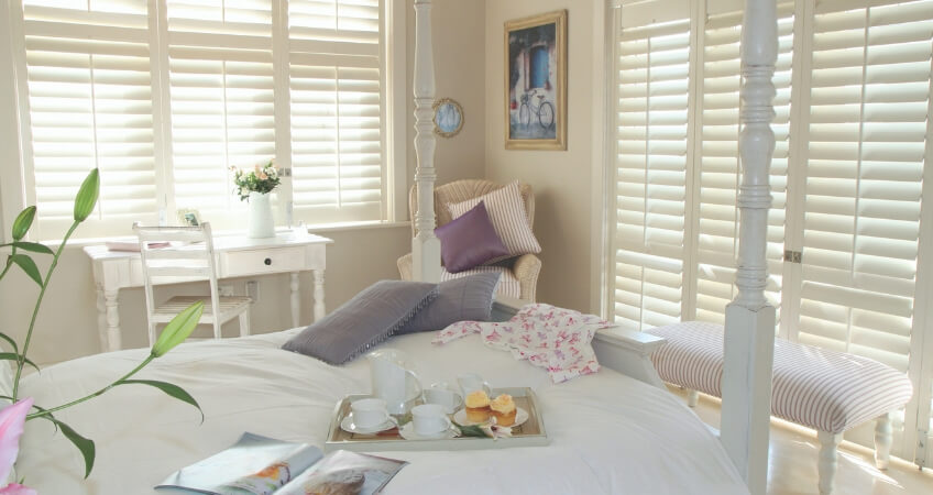 plantation shutters for roman blinds